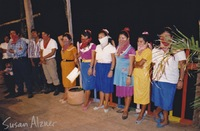 Zapatista men and women on stage during Indigo Girls and Michelle Malone performance for the village of La Realidad in Chiapas, Mexico