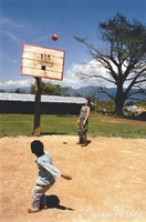 Amy Ray of Indigo Girls plays basketball with children in the Zapatista village of La Realidad in Chiapas, Mexico